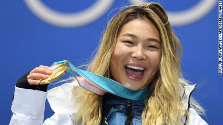 USA's gold medallist Chloe Kim poses on the podium at the 2018 Winter Olympic Games.