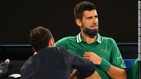 Djokovic receives treatment during his third-round game.