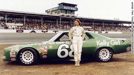 Driver Janet Guthrie stands in front of her No. 68 Chevrolet Chevelle Laguna before the 1977 Daytona 500. She was the first female driver to compete in the race.