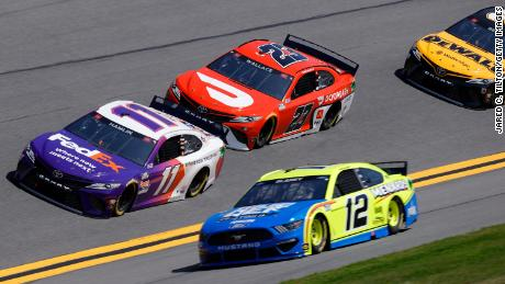 Drivers Denny Hamlin in the No. 11 FedEx Toyota, Bubba Wallace, in the No. 23 DoorDash Toyota, and Ryan Blaney in the No. 12 Menards/Blue DEF/PEAK Ford during practice laps 63rd Annual Daytona 500 at Daytona International Speedway on February 10, 2021.