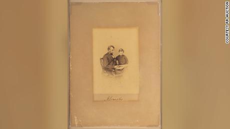 Original albumen 3.75ʺ x 5.25ʺ photograph of President Abraham Lincoln with his son Tad, taken by Mathew Brady on February 9, 1864.