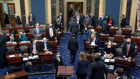 "WASHINGTON, DC - FEBRUARY 13: In this screenshot taken from a congress.gov webcast, the House impeachment managers are escorted out after the Senate voted 57-43 to acquit on the fifth day of former President Donald Trump's second impeachment trial at the U.S. Capitol on February 13, 2021 in Washington, DC. House impeachment managers had argued that Trump was ""singularly responsible"" for the January 6th attack at the U.S. Capitol and he should be convicted and barred from ever holding public office again. (Photo by congress.gov via Getty Images)"