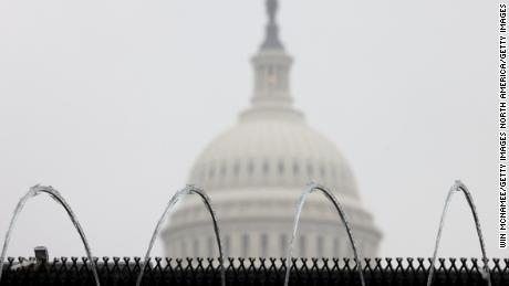 WASHINGTON, DC - FEBRUARY 13:  Razor wire is shown atop a fence outside the U.S. Capitol during the fifth day of former President Donald Trump's impeachment trial February 13, 2021 in Washington, DC. The Senate is expected to conclude their deliberations and vote later today. (Photo by Win McNamee/Getty Images)