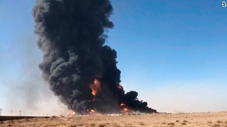 Smoke rises from fuel tankers at Afghanistan's Islam Qala border with Iran, in Herat Province, on February 13, 2021.