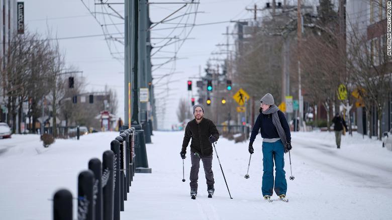 People ski down the Max tracks on North Interstate Avenue in Portland, Oregon, Saturday.