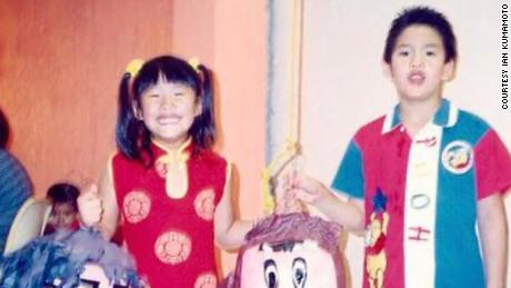 Kumamoto's sister Elizabeth and brother Ivan dressed up in pre-school in Mexico.