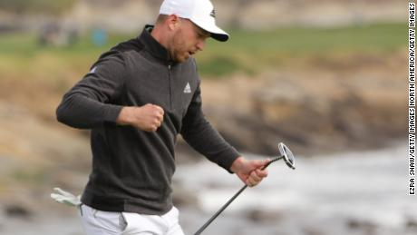 Daniel Berger celebrates his eagle putt to win on the 18th.
