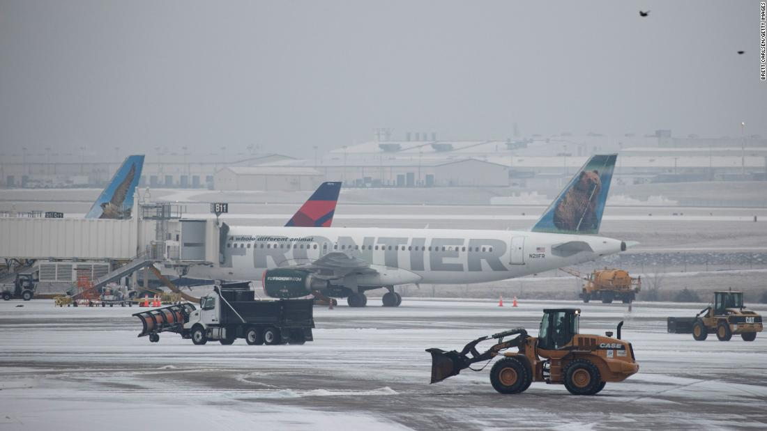 Vehicles clear ice at the international airport in Nashville, Tennessee, on Monday.