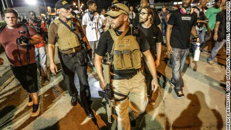 Armed swearers went to Ferguson, Missouri, after the murder of Michael Brown in 2014 and again, pictured, a year later.