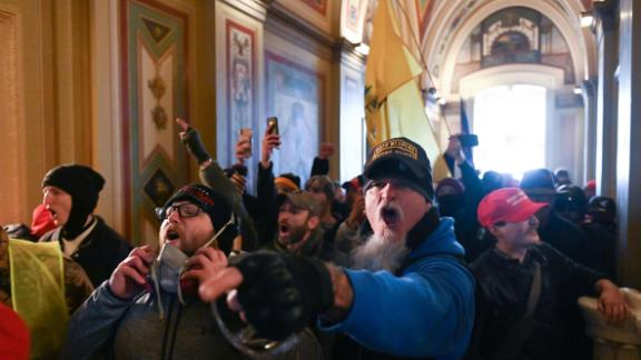 A man wearing an Oath Keepers hat yells in the hallways of the Capitol during the invasion by rioters on January 6.