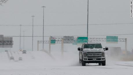 Vehicles driving on snow-covered Interstate 10 Monday in Houston.