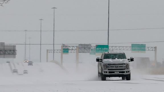 Vehicles driving on snow-covered Interstate 10 Monday, Feb. 15, 2021, in Houston. A winter storm making its way from the southern Plains to the Northeast is affecting air travel. (Yi-Chin Lee/Houston Chronicle via AP)