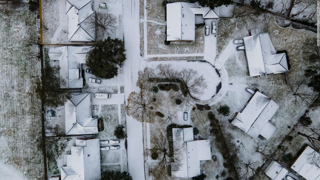 Homes in the Westbury neighborhood of Houston are covered in snow on Monday, February 15.