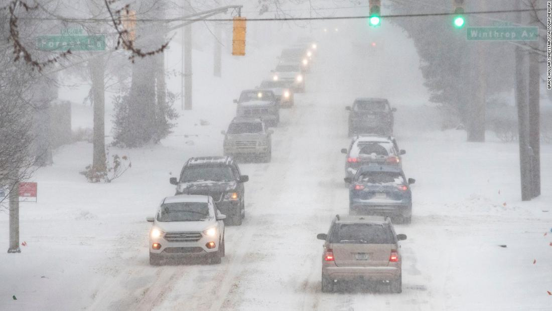 Motorists take it slow in Indianapolis on Monday.