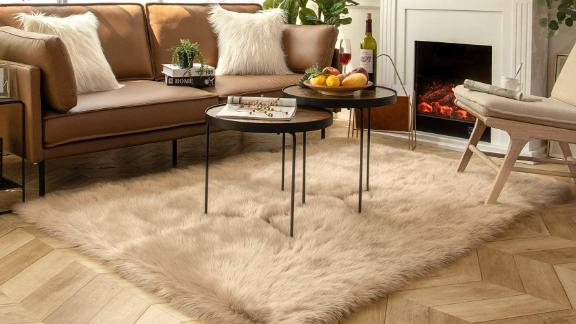 Ashler Faux Fur Beige Rectangle Area Rug