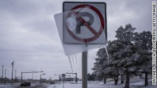 Ice coats a road sign in Midland, Texas, U.S, on Monday, Feb. 15, 2021. Blackouts triggered by frigid weather have spread to more than four million homes and businesses across the central U.S. and extended into Mexico in a deepening energy crisis that's already crippled the Texas power grid. Photographer: Matthew Busch/Bloomberg via Getty Images