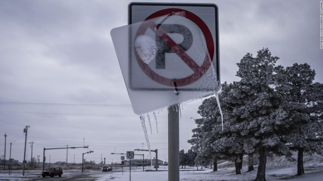 Ice coats a road sign in Midland, Texas, on Monday.