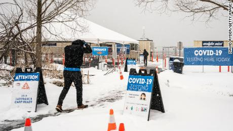 People enter a Covid-19 testing site Saturday in Seattle, Washington.