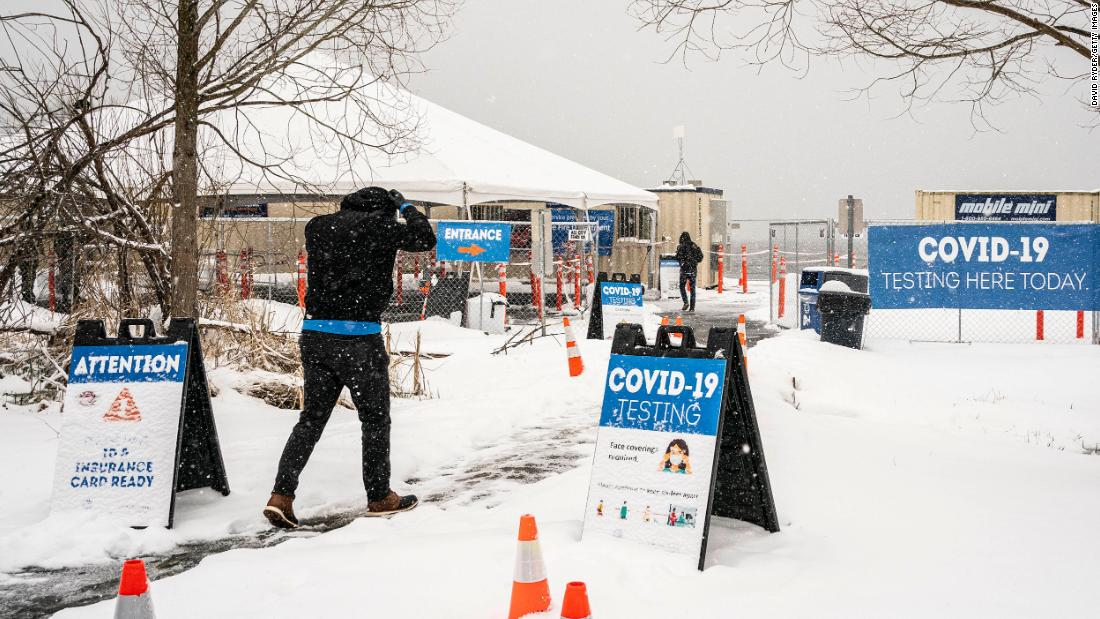 People enter a Covid-19 testing site in Seattle on Saturday. Seattle reported more than 11 inches of snow over the weekend, its most since January 1972.