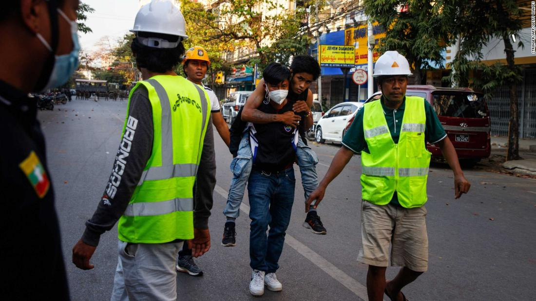 Medics clear the way as an injured protester is carried away for treatment in Mandalay, Myanmar, on February 15.