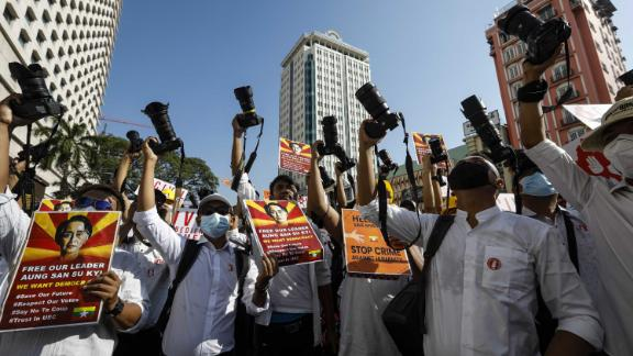 Members of the Myanmar Photographers Association hold up their cameras as they call for Suu Kyi's release on February 13.