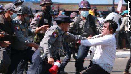 Police arrest a protester during a demonstration against the military coup in Mawlamyine, Mon State on February 12.