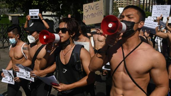 Bodybuilders take part in a protest in Yangon on February 11.