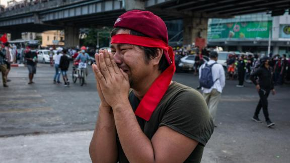 A protester pleads for police to refrain from using tear gas against demonstrators in Yangon on February 9.