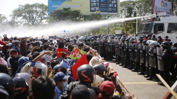 Police fire water cannons at protesters in Naypyidaw on February 9.