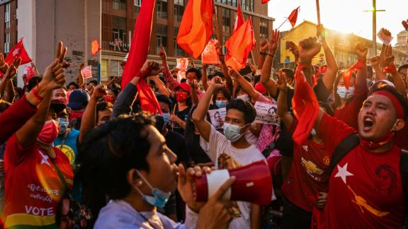 Protesters shout slogans in Yangon on February 7.