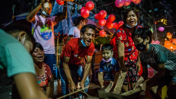 Yangon residents bang objects to show support for Suu Kyi and her party on February 5.
