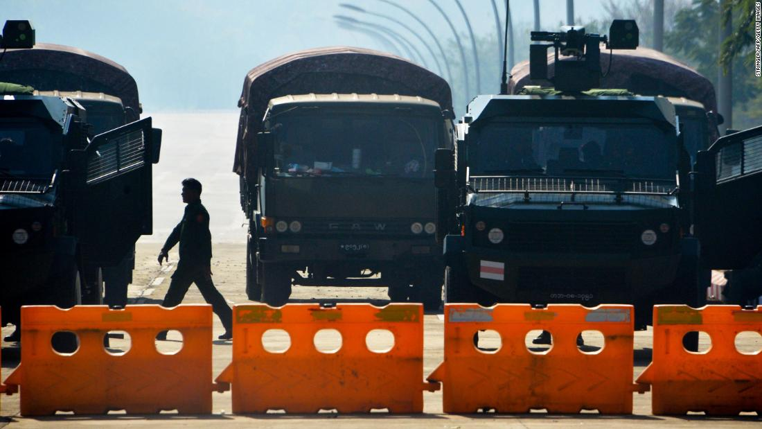 Soldiers block a road near Myanmar's Parliament on February 2, a day after the coup.