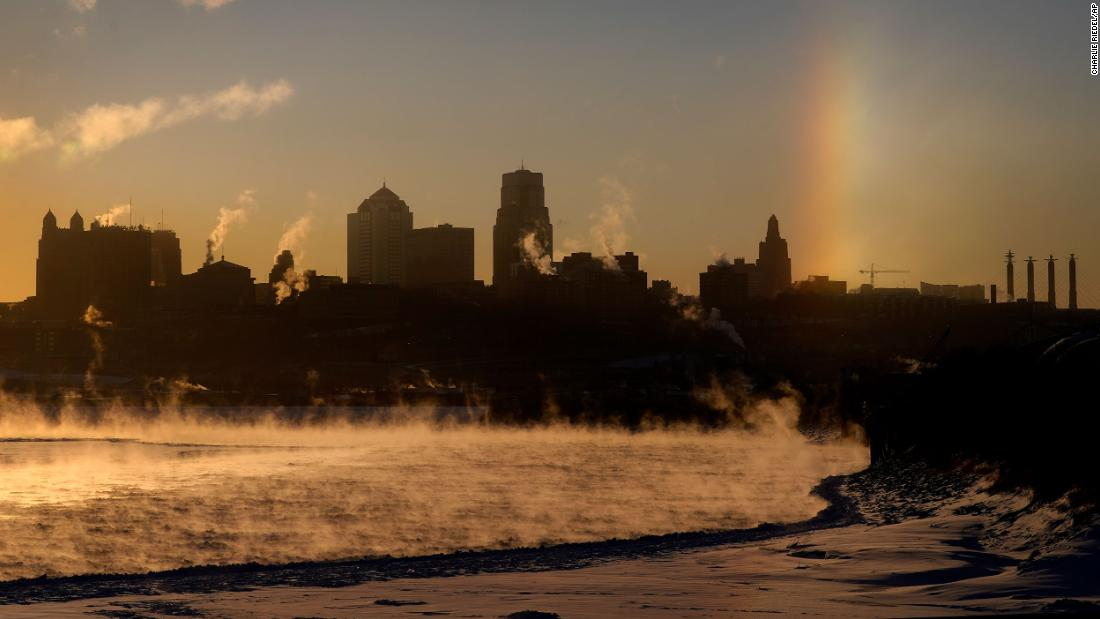Steam rises off the frozen Missouri River in Kansas City.