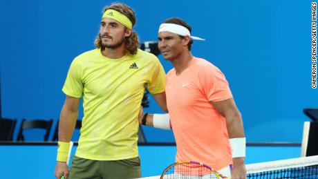 Tsitsipas and Nadal pose prior to their match.