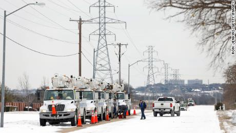 Electric service trucks line up in Fort Worth, Texas, after historic cold, snow and ice knocked out power to millions across the state.