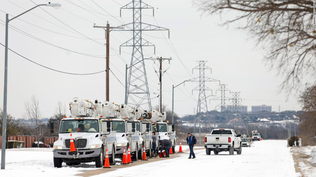 Electric service trucks line up in Fort Worth, Texas, on Tuesday.