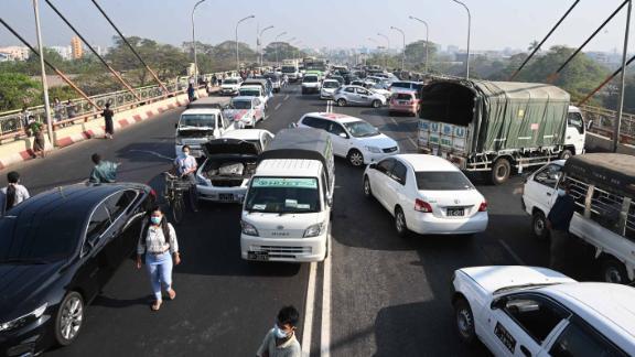 Demonstrators block a Yangon bridge with their cars on February 17.