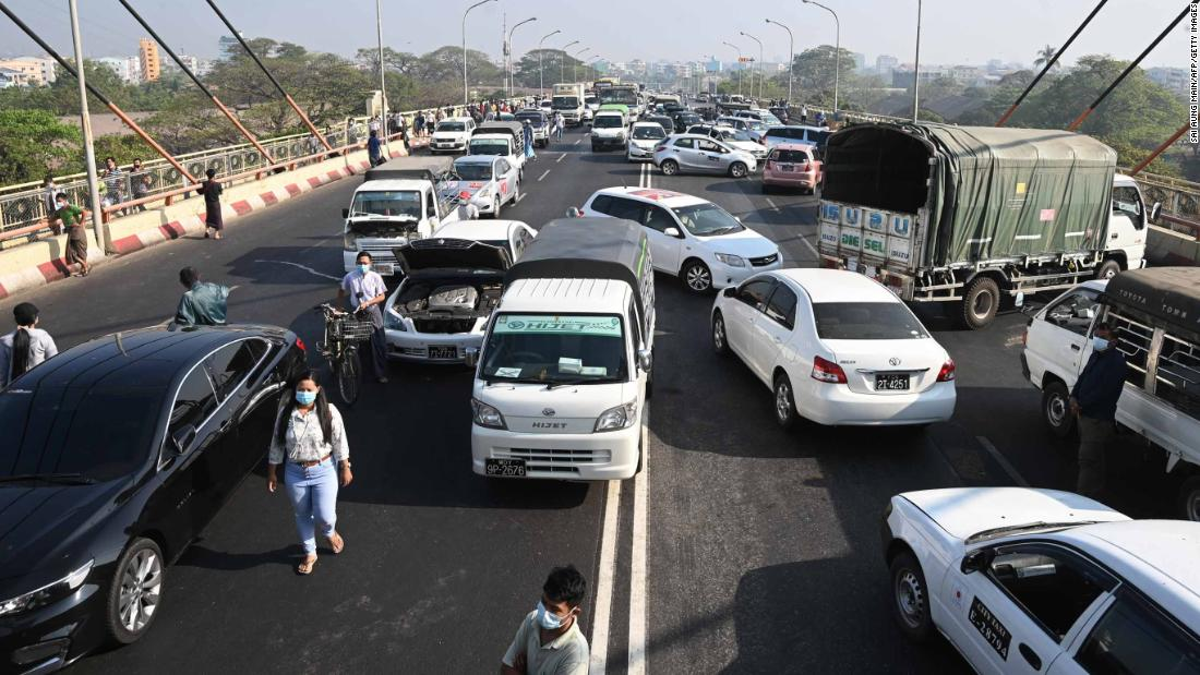 Demonstrators block a Yangon bridge with their cars on February 17.