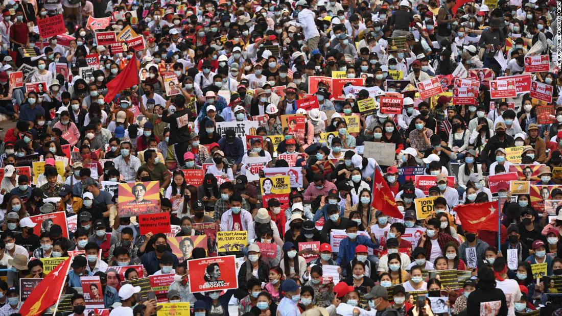 Protesters block a major road during a demonstration in Yangon on February 17.
