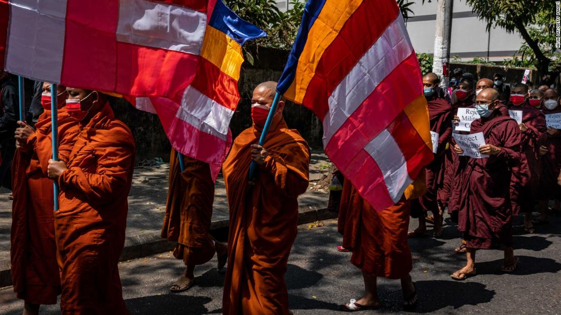 Buddhist monks march during an anti-coup protest in Yangon on February 16.