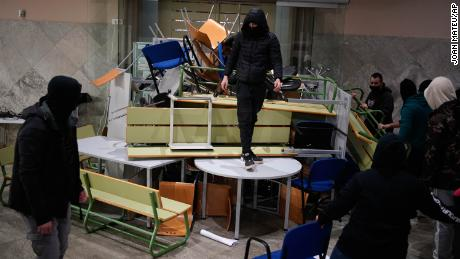 Hasel's supporters make barricades inside the University of Lleida on Monday.