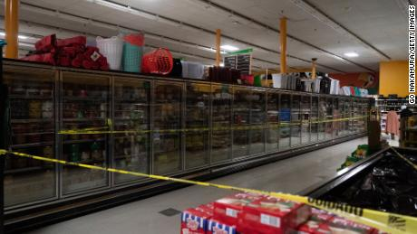 Freezer sections are closed off in Fiesta supermarket on Tuesday in Houston, Texas.
