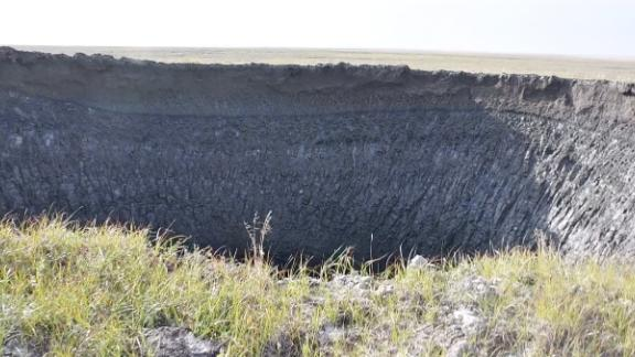 A massive crater appeared violently and explosively in the Siberian tundra last year -- a powerful blowout of methane gas throwing ice and rock hundreds of feet away and leaving a gaping circular scar in the empty and eerie landscape.
