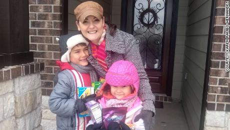 Karen Rambo-Hernandez and her children, Clark (left) and Clara, were excited to find boxes of Girl Scout cookies and hot cocoa mix on their doorstep, left by a kind neighbor.