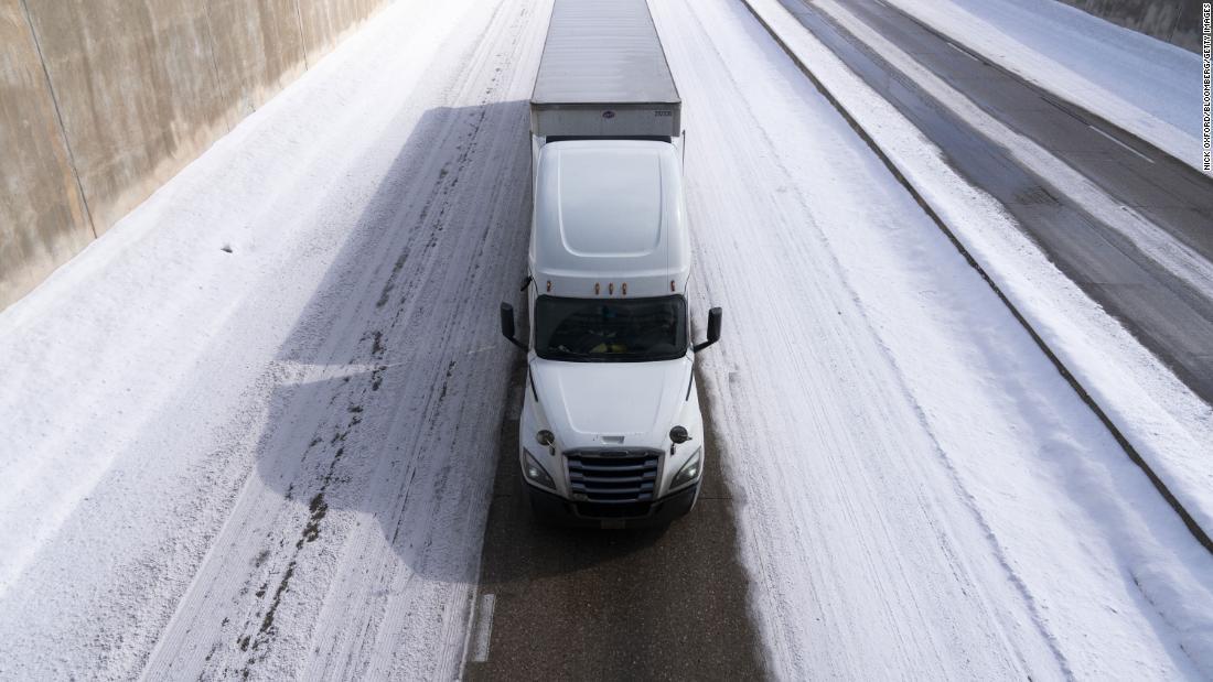 A truck travels along a snow-covered Interstate 44 in Oklahoma City on Wednesday.