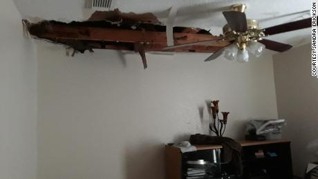 Sandra Erickson's ceiling in her rented home collapsed due to pipes bursting.