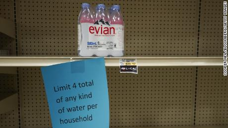 A sign on a nearly empty shelf at a grocery store in McKinney on February 17.