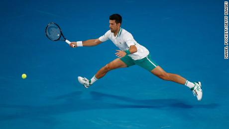 Djokovic plays a forehand against Karatsev.