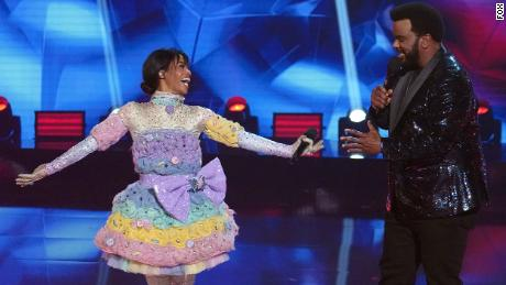 """THE MASKED SINGER: L-R: Gabby Douglas and host Craig Robinson in the """"Road to the Finals -- Final Clues to the Mask!/ The Finale -- One Last Mask!"""" special two-hour season finale of THE MASKED DANCER airing Wednesday, Feb. 17 (8:00-10:00 PM ET/PT) on FOX.  © 2021 FOX Media LLC."""