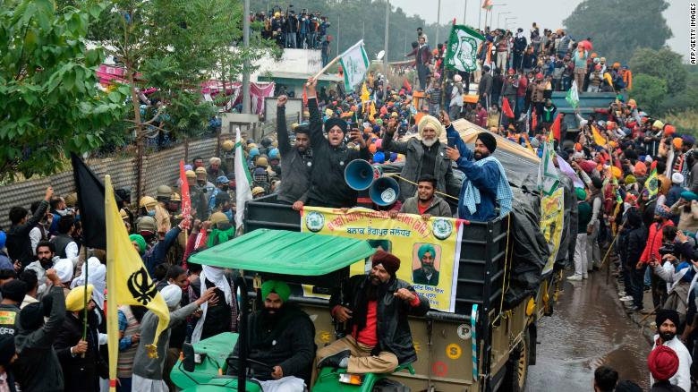 Farmers march to India's capital New Delhi to protest against the central government's recent agricultural reforms, in Ambala on November 26, 2020.